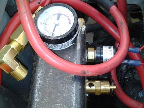 manifold with gauge, blow off valve, pressure switch.