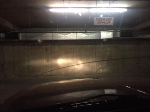 Stock sealed beams shining in underground lot. Super dim.